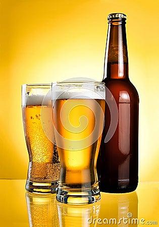 Two glasses and Bottle of fresh light beer