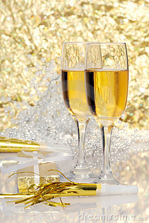 Two glasses champagne with gift and horns