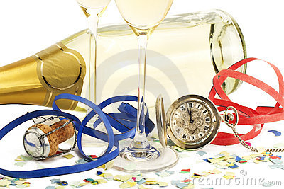 Two glasses with champagne, old pocket watch, stre