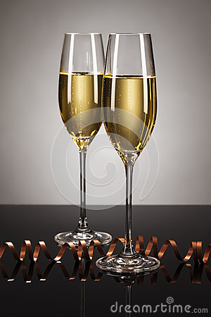 Two glasses of champagne with a streamer