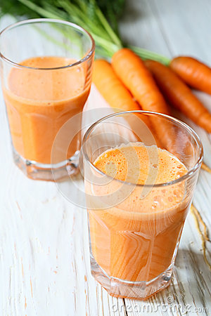 Two glasses of fresh carrot juice