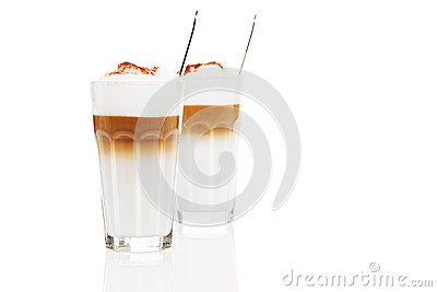 Two glasses latte macchiato with chocolate powder