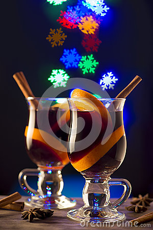 Two glasses of mulled wine on bokeh snow flake background
