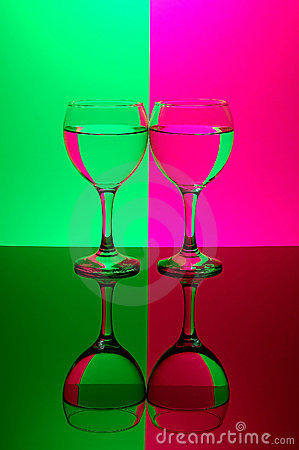 Two glasses on neon background