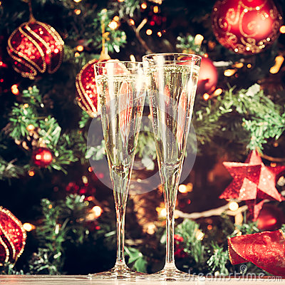 Free Two Glasses Of Champagne With Christmas Tree Background. Holiday Royalty Free Stock Images - 77788329