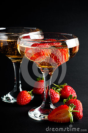 Free Two Glasses Of Cold Champagne With Strawberries Stock Photo - 33445980