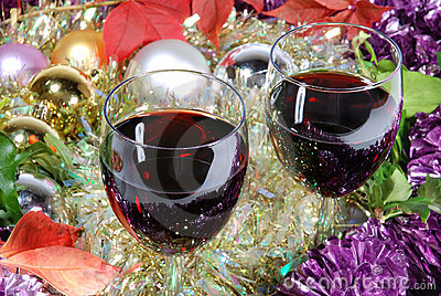 Two glasses of red wine on a Christmas background