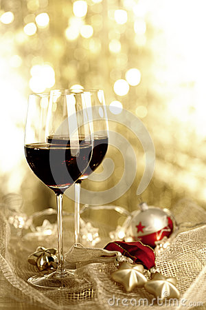 Two glasses of Red Wine and Christmas Ornaments