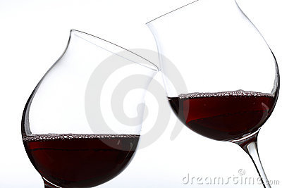 Two glasses of red wine toasting