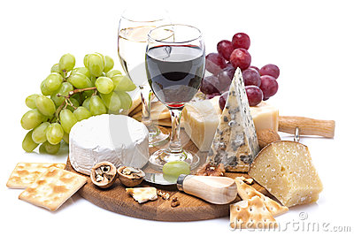 Two glasses of wine, grapes, cheese and crackers