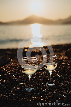 Free Two Glasses With White Wine On The Beach At Sunset Stock Image - 106853851