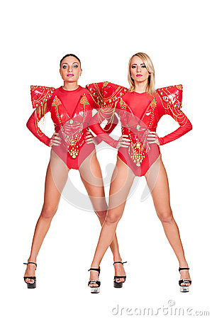 Two go-go dancers in red stage costume