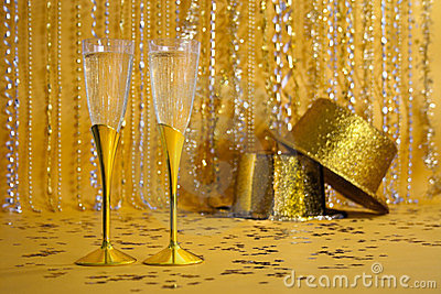 Two Gold Champagne Flutes with Sequined Party Hats