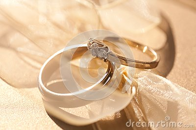 Two gold wedding rings with tender ribbon around