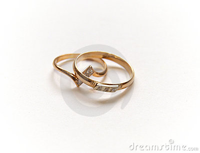 Two gold wedding rings on white.
