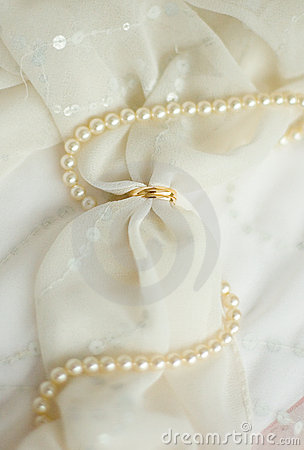 Two golden wedding rings on bridal veil