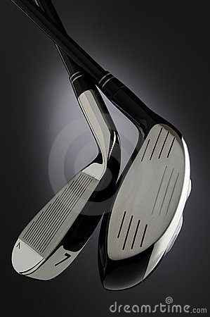 Two Golf Clubs on Dark Background