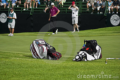 Two Golfers Club Bags Editorial Stock Image