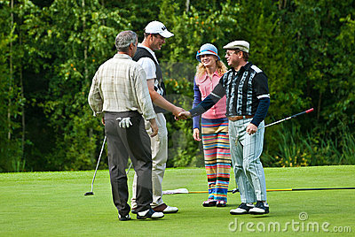 Two golfers shake hands on golf feeld Editorial Photography
