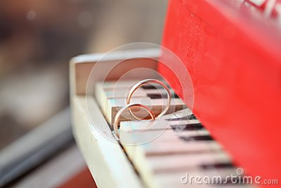 Two golgen rings on piano