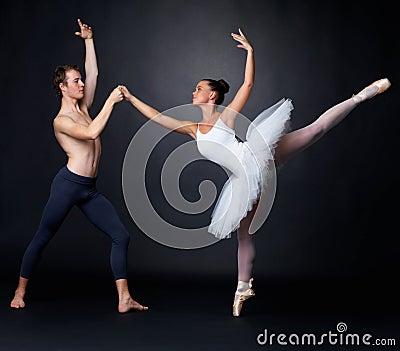Two graceful ballet dancers performing