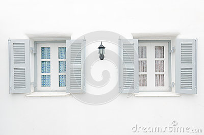 Two Gray windows with blue curtain and pink curtai