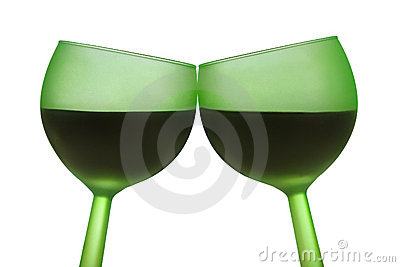 Two green glasses with red wine