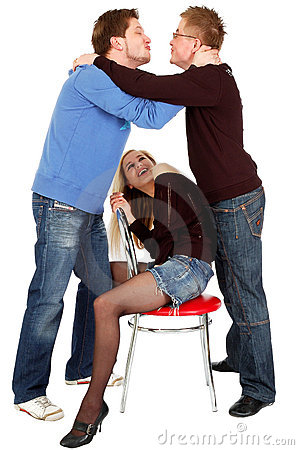 Two guys kissing in front of a sitting pretty girl