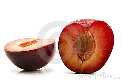 Two half wet plums