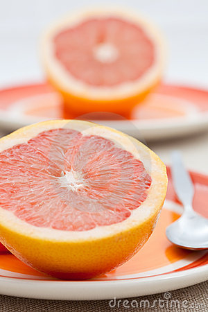 Free Two Halves Of Pink Grapefruit Stock Photo - 13542310