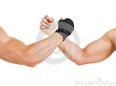 Two hands clasped arm wrestling, the struggle of black and white