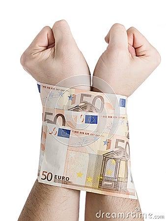 Two hands cuffed bills 50 euros