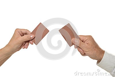 Two hands holding empty blank cards isolated Stock Photo