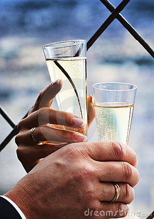 Two hands holding wedding champagne