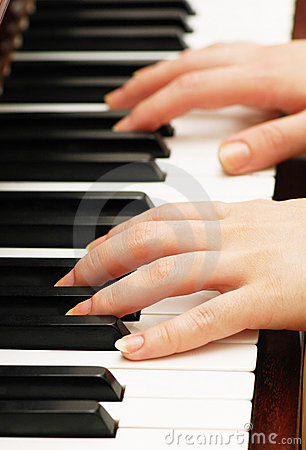 Two hands playing music