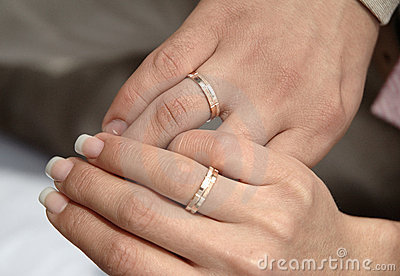 Two hands with rings on weddings day