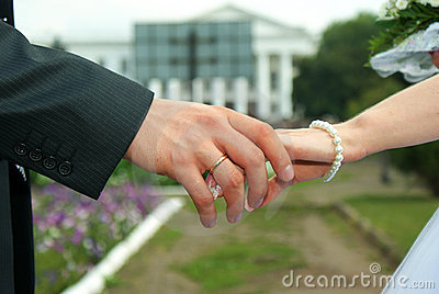 Two hands with wedding rings.