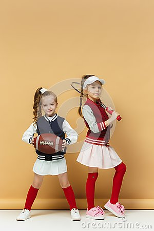 Free Two Happy And Beautyful Children Show Different Sport. Studio Fashion Concept. Emotions Concept. Stock Image - 112570601