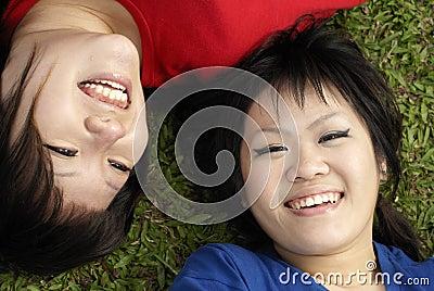 Two happy asian teen girls
