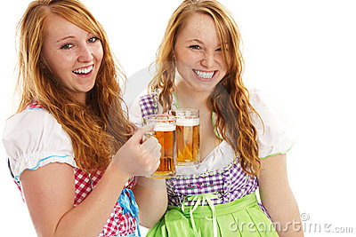 Two happy bavarian girls with beer