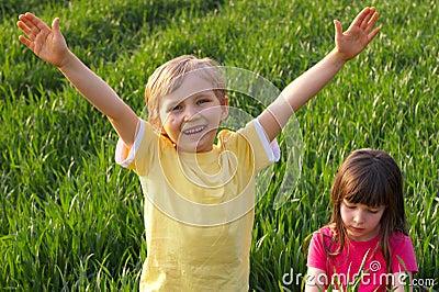 Two Happy Children in Meadow