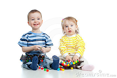 Two happy children play together with mosaic toy