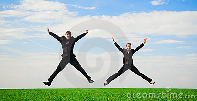 Two happy colleagues in jump
