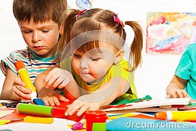 Two happy creative kids