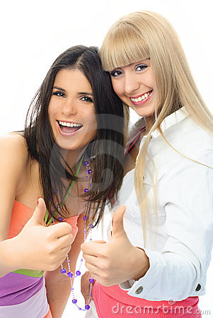 Two happy excited girls with their thumbs up