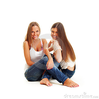 Two happy girls in jeans