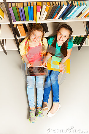 Free Two Happy Girls Portrait From Above Sit On Floor Stock Image - 41250911