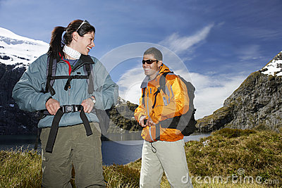 Two Happy Hikers On Mountain Landscape