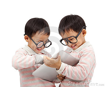Two happy kids using touch pad computer