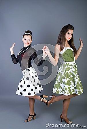 Two  happy retro-styled girls